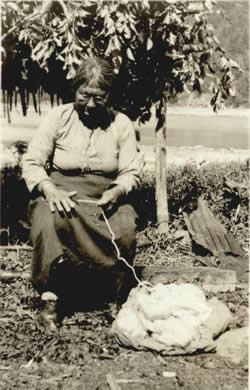 Tlingit woman hand-spinning mountain goat wool.