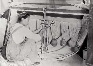 Tlingit woman weaving a Chilkat Blanket.